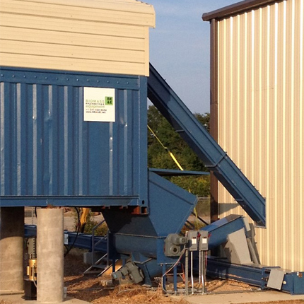 SMART Container with walking floors or live floors that receives and meters biomass for gasification in Tennessee.