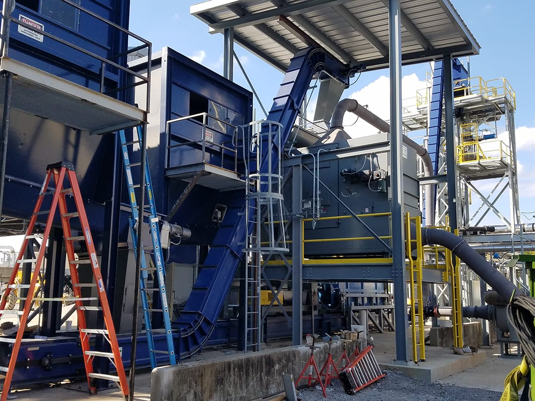 Drag Chain Conveyors for recycled tires - automated material handling equipment with dust-tight performance.